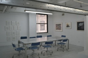 "Exhibition space with ""Collaborations"" show on the walls"